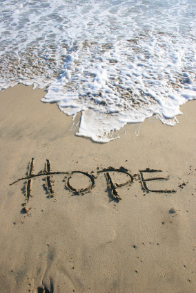 hope on beach with wave
