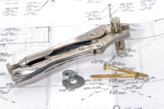 Lock grip pliers over house plan