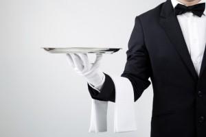 bigstock-Waiter-holding-empty-silver-tr-42965686-640x428